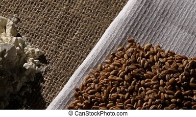 Handfuls of bulk food products. Close up. Rotating - Wheat...
