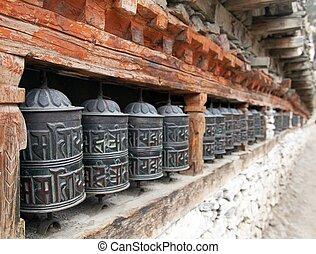 Buddhist many prayer wheels - view of Buddhist many prayer...