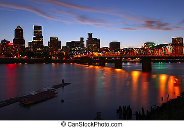 Portland Oregon at dusk. - City lights and dispersed clouds...