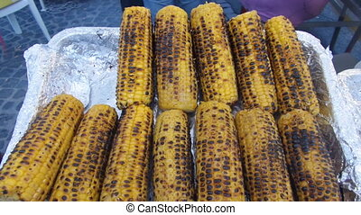 Grilled Sweet Corn - Stand with grilled corn in outdoor...