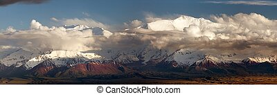 Evening panoramic view of Lenin Peak from Alay range -...