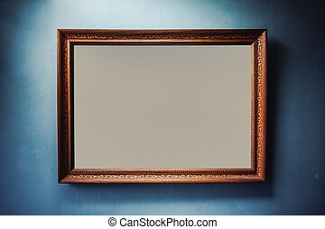 Old Wooden Frame - Empty wooden frame on pale blue wall with...