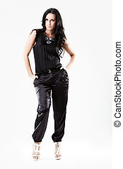 Slim young woman dressed in black trousers