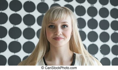 Blonde girl aged 20s with a thick hair - Slim blonde girl...