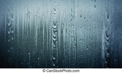 Rain Falling On Window Pane - Rain hits glass window shallow...
