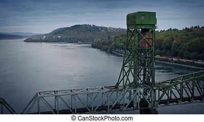 Train And Bridge Over Estuary - Large industrial bridge over...