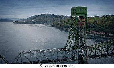 Train And Bridge Over Estuary - Large industrial bridge over...