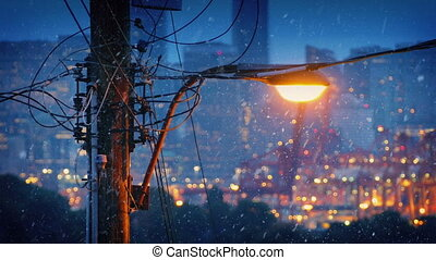 Streetlight In City In Snowfall - Street light with city...