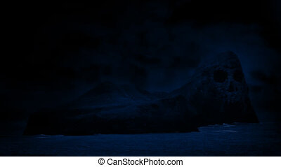 Skull Island In Sea At Night - Rocky island out at sea with...