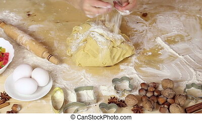 girl hands roll out the dough for christmas cookies - girl...