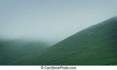 Thick Mist Moving Over Hills