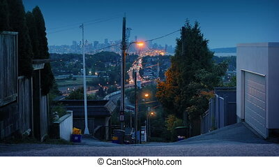 View From Hillside To City At Dusk - Looking down from...