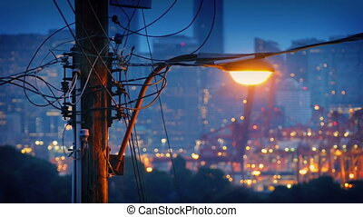 Streetlight With City Twinkling - Streetlight glowing near...
