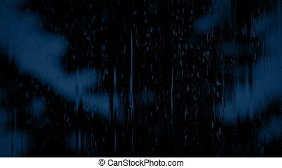 Tree Through Rainy Window At Night - Large tree in heavy...