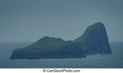 Rocky Island In The Ocean - Rugged island in the sea on...