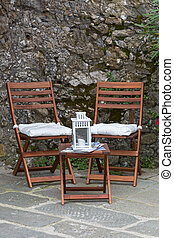 Foldable wooden chairs, mini table with candle lantern on top