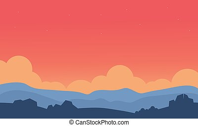 Silhouette of hill and orange sky