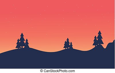 Silhouette of hill and spruce scenery