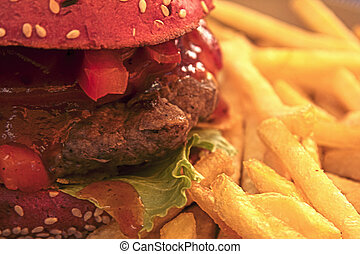 Beef burger and fries plate - Fresh, juicy burger with tangy...