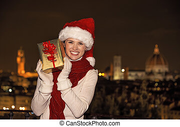 woman at Piazzale Michelangelo showing Christmas present box...