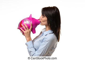 Woman kissing a piggy bank in her hands