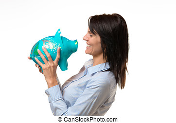 Laughing lady holding a piggy bank in her hands