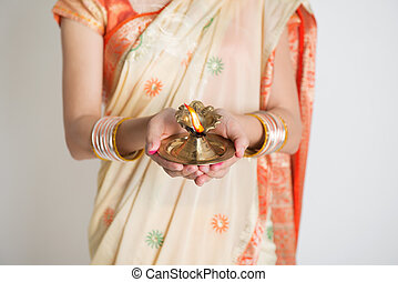 Happy diwali - Indian girl in traditional sari dress,...