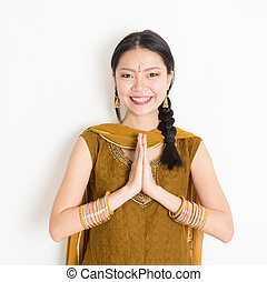 Mixed race young Indian woman greeting - Portrait of young...