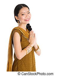 Woman in Punjabi clothes greeting. - Young mixed race Indian...