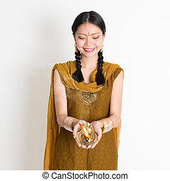 Girl holding oil lamp light