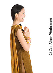 Young girl in Punjabi clothes greeting. - Side view young...