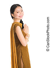 Young girl in Punjabi skirt greeting. - Portrait of young...