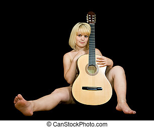 Nude girl with acoustic guitar