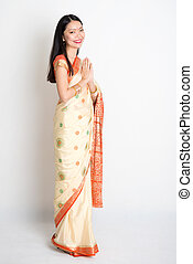 Woman with greeting pose - Full length mixed race Indian...