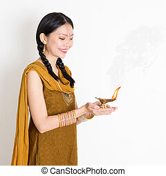 Woman holding oil lamp