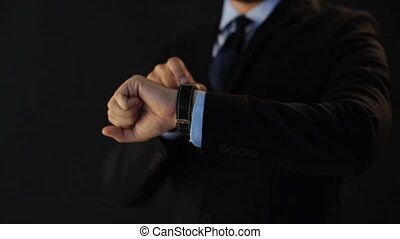 businessman pointing to smart watch on his hand - time,...
