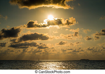 Beautiful sunset with clouds in a golden sea
