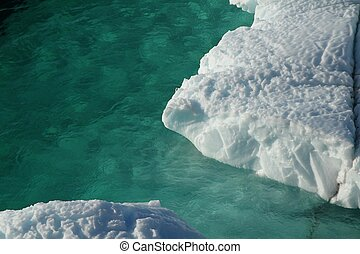 Iceberg in turquise water - turquise water with drift ice