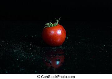 Tomato isolated on black background - Fresh tomato with...