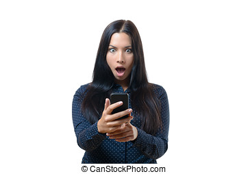 Young woman reacting in horror to her mobile - Young woman...