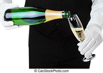 Waiter pouring champagne into glass isolated on white...