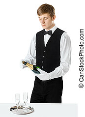 Young handsome waiter opening bottle of champagne - Portrait...