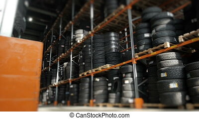 Car Tires At Warehouse In Tire Store. A Huge Warehouse of a...