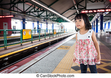 Asian Chinese Little Girls Waiting for Light Rapid Transit