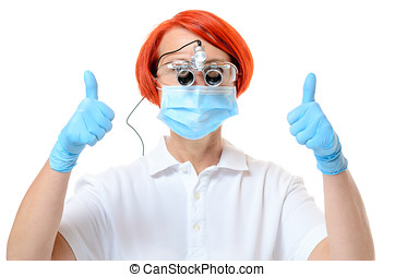 Doctor wearing surgical instrument and mask give two thumbs...