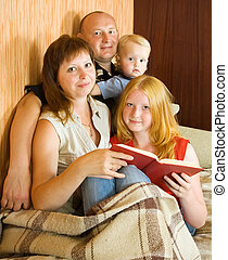 family reading an interesting book - Image of happy family...