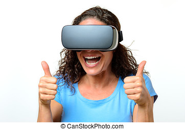 Woman wearing a pair of virtual reality goggles laughing and...