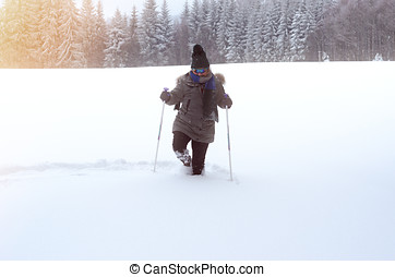 Front view of a person walking through deep snow