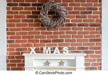 Decorated Christmas fireplace on a brick wall