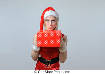 sulking woman holding a Christmas gift